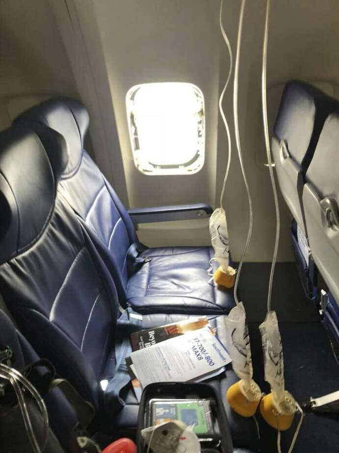 This April 17, 2018 photo provided by Marty Martinez shows the window that was shattered after a jet engine of a Southwest Airlines airplane blew out at altitude, resulting in the death of a woman who was nearly sucked from the window during the flight of the Boeing 737 bound from New York to Dallas with 149 people aboard, after it made an emergency landing in Philadelphia. Photo: Marty Martinez /AP / Marty Martinez