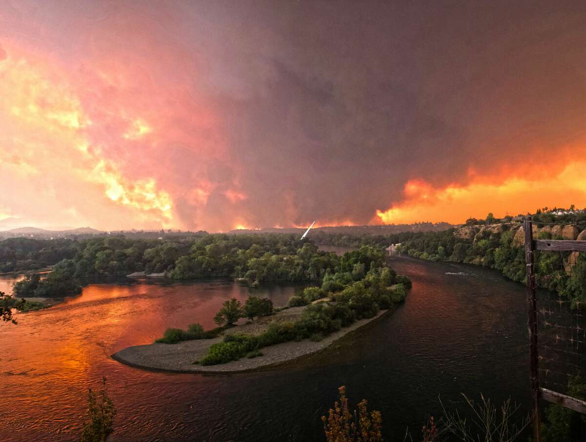 A panoramic photo taken by Redding resident Cody Markhart shows the Carr Fire with the Sundial Bridge in the foreground on Thursday, July 26, 2018.