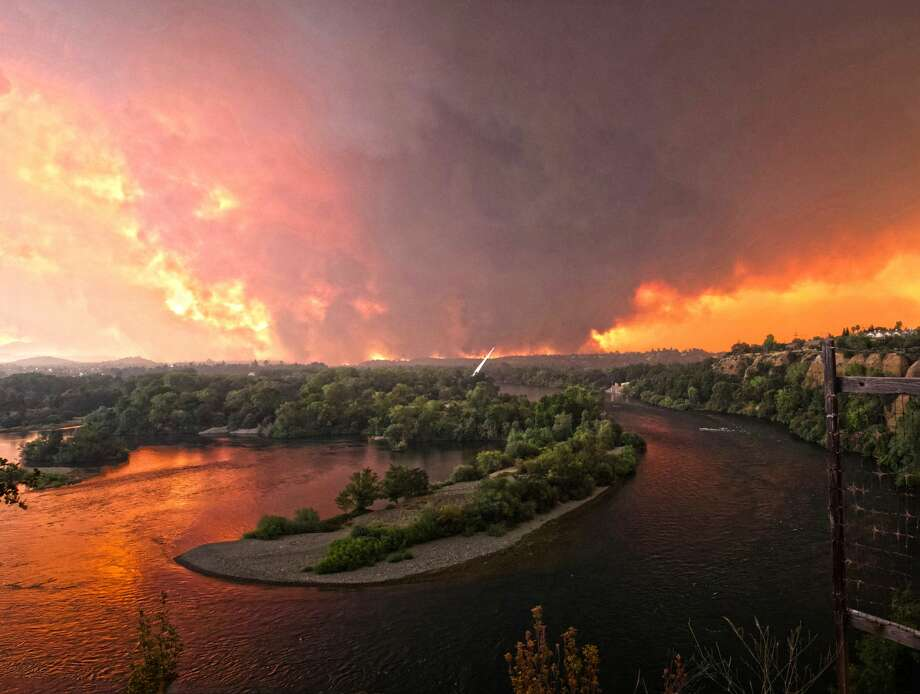 A panoramic photo taken by Redding resident Cody Markhart shows the Carr Fire with the Sundial Bridge in the foreground on Thursday, July 26, 2018. Photo: Cody Markhart