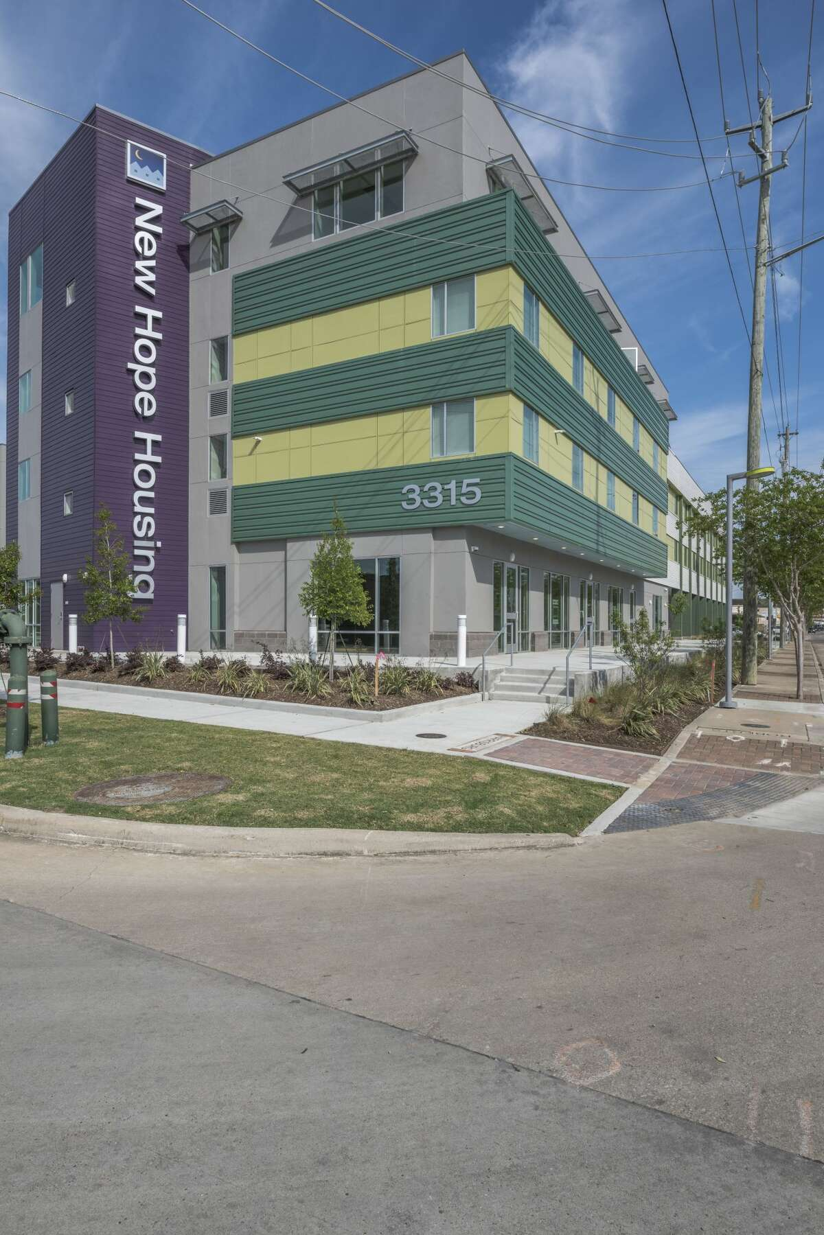 New Hope Housing at Harrisburg is a mixed-use development that incorporates street-level retail and commercial office space with single-room occupancy residential apartment homes.