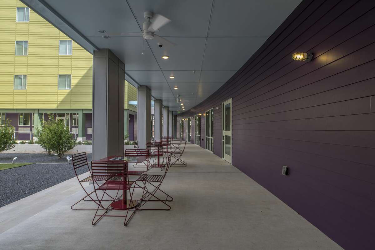 Movable furniture in the outdoor courtyard is a common feature among New Hope Housing developments.