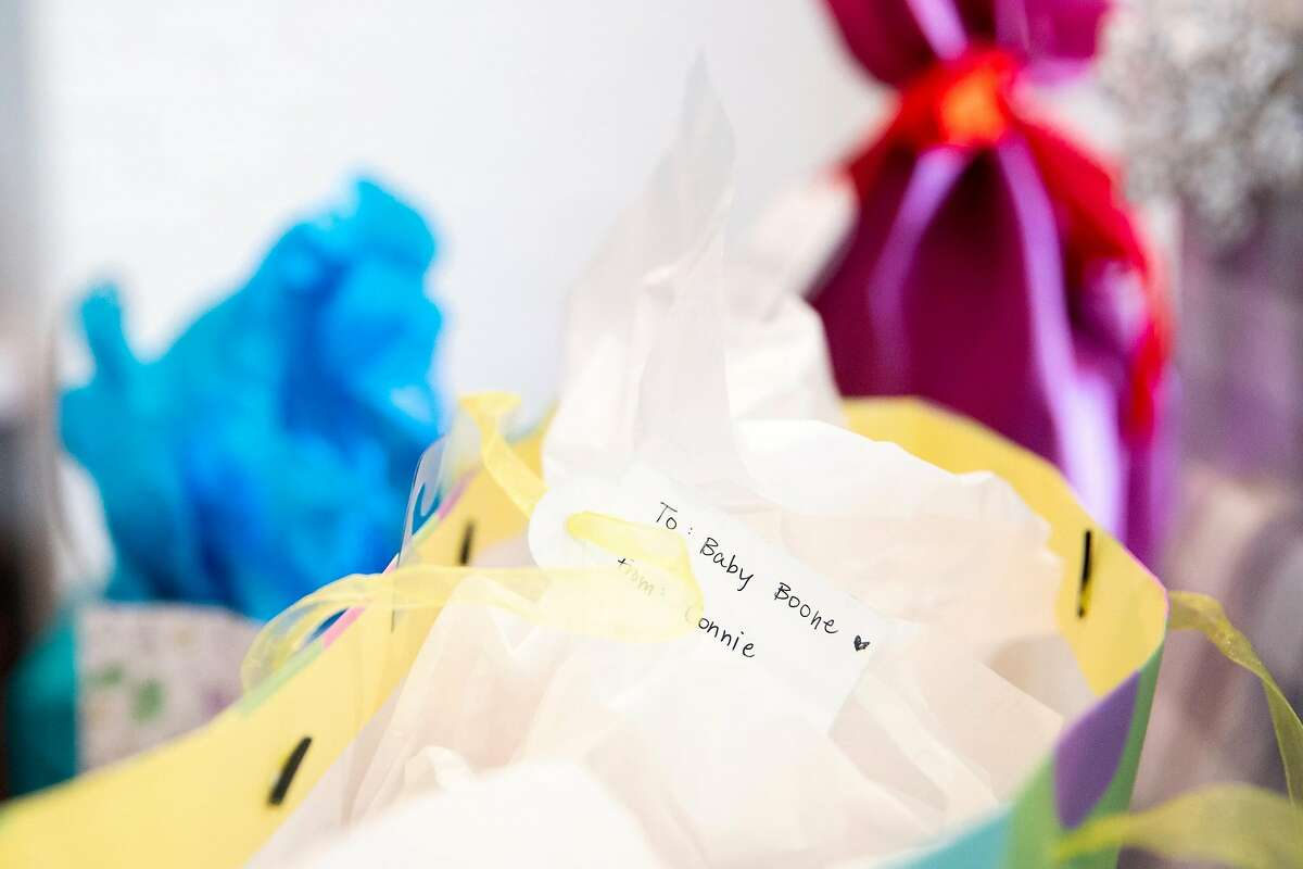 """Presents for Baby Boone wait to be opened on a table during a baby shower for Andrea Schwartz Boone and her husband Derrick Boone in Orinda, Calif. on Saturday, July 21, 2018. The couple used a new """"universal baby registry"""" called Baby List which allows expectant parents to not only register for items on the Baby List website but also gifts for charities, hands-on help with meals and chores, and meal deliveries."""
