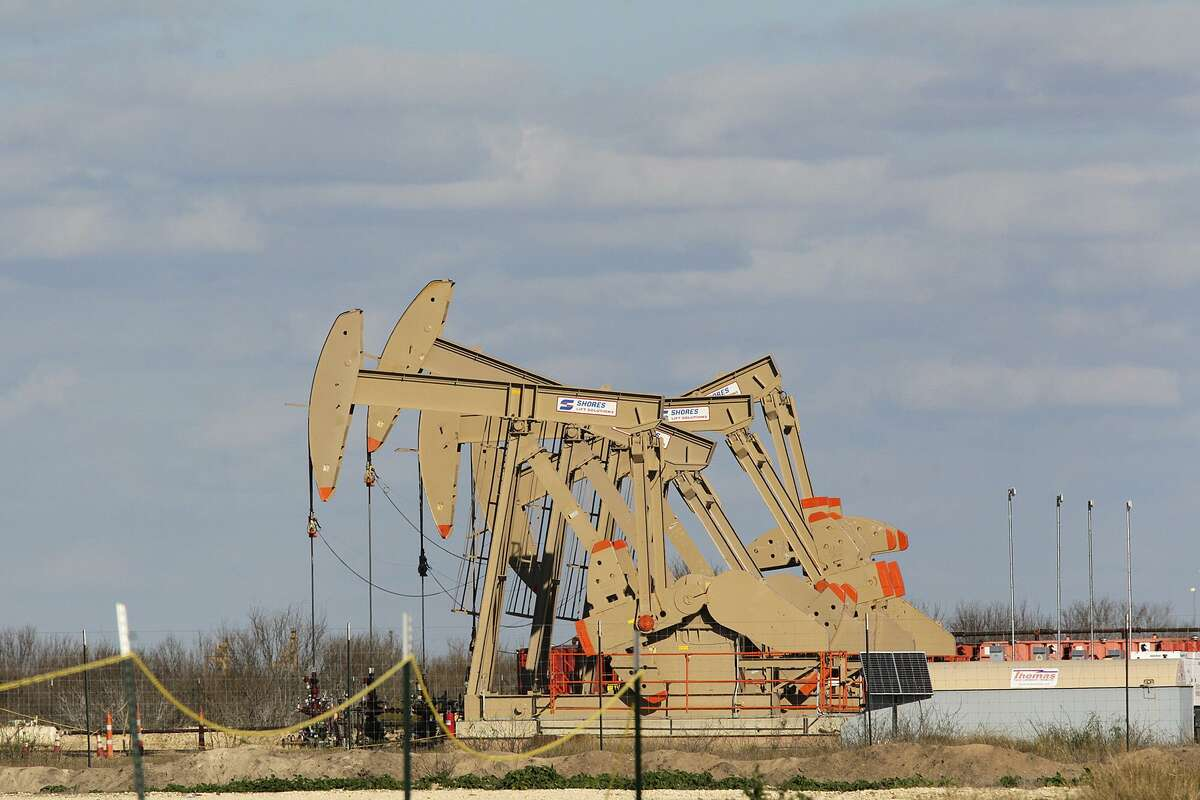 Pump jacks extract oil and gas from the Eagle Ford Shale at a pad off Texas State Highway 72 east of Tilden, Texas, Thursday, February, 19, 2015.