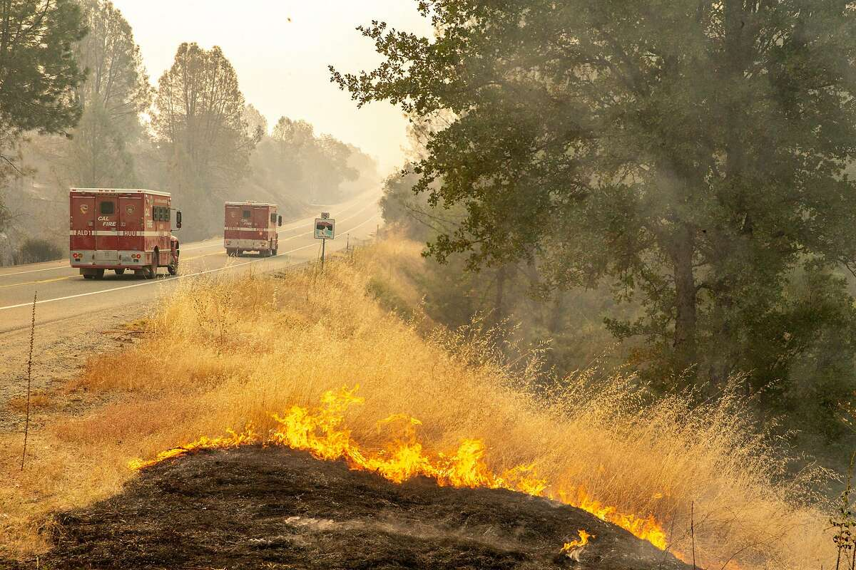 Cal Fire vehicles head towards Redding from Shasta along Highway 299 on July 27, 2018.