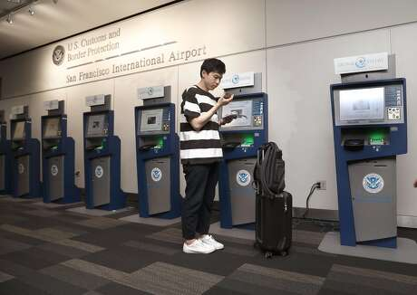 Kihyun Yoon checks in using the Global Entry computers at the U.S. Customs and Border Protection at the San Francisco International airport on Thursday, July 26, 2018 in San Francisco, Calif.