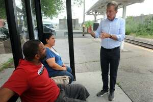 Democratic gubernatorial candidate Ned Lamont speaks to Alexander Capeles and Ana Houston, both of Ansonia, as they wait to catch the Waterbury line Metro-North train to Waterbury at the Ansonia train station, in Ansonia, Conn. July 23, 2018.