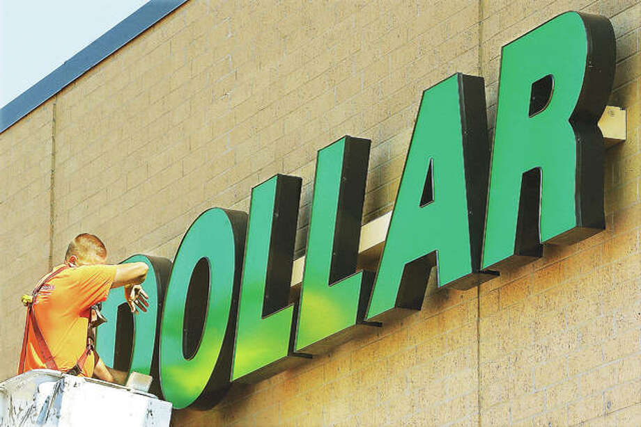 It was another day and another dollar working in the hot sun this week for employees of Plasti-Lite Signs from St. Louis who were installing the Dollar Tree signage on the new store, which will be located in the East Alton Islands when it opens in the coming weeks. Photo:       John Badman | The Telegraph