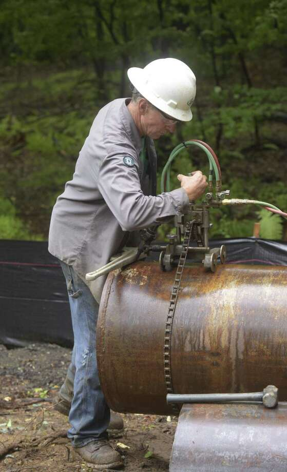 Phillip Tripp, from Layne, sets up a pipe cutter at the site of new test well for the Bethel water system on Wednesday  in Bethel . Photo: H John Voorhees III / Hearst Connecticut Media / The News-Times