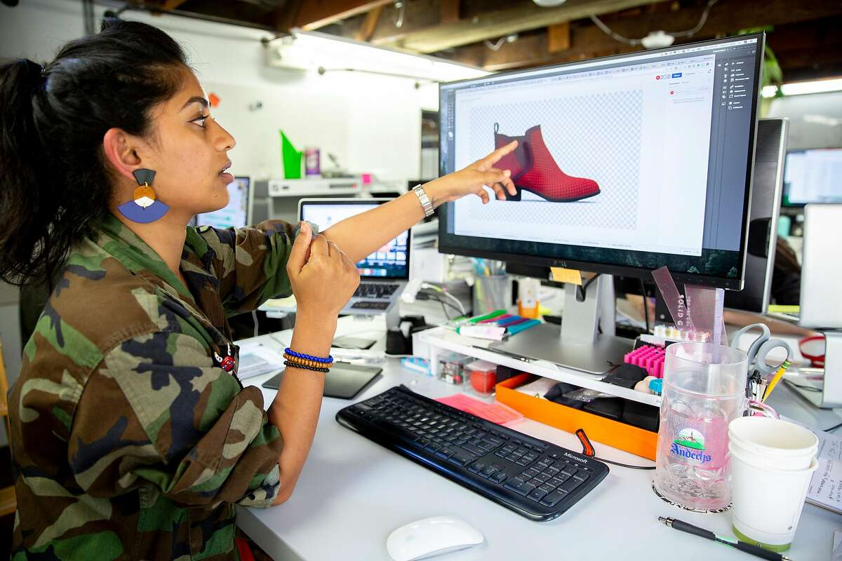 Womenswear designer Ayesha Tellis shows the rendering of the Tennis Western Boot in ruby at Betabrand, Thursday, July 26, 2018, in San Francisco, Calif. The retail clothing company is located at 780 Valencia St.