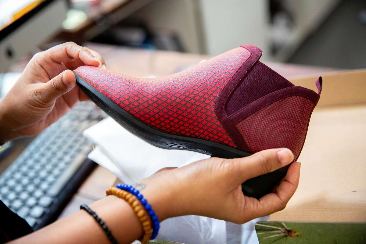 Womenswear designer Ayesha Tellis displays the Tennis-Western Boot in ruby at Betabrand, Thursday, July 26, 2018, in San Francisco, Calif. The retail clothing company is located at 780 Valencia St.
