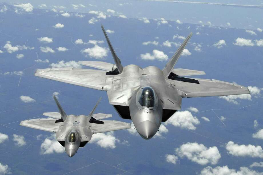A reader says the U.S. spends enough on the military. Here, two U.S. Air Force F-22 Raptor aircraft participate in a training mission off the coast of Florida in 2007. Photo: U.S. Air Force / US AIR FORCE