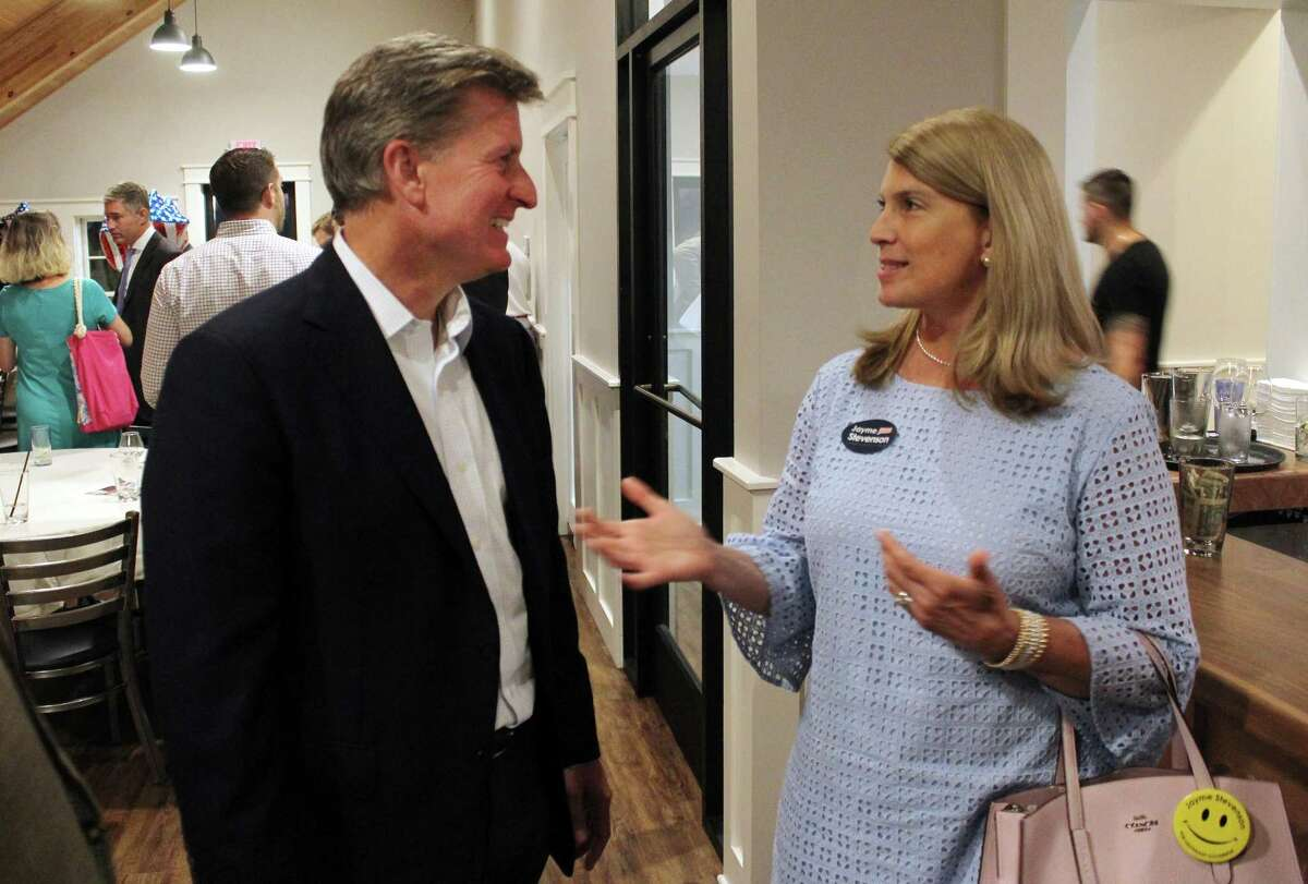 Republican gubernatorial candidate Steve Obsitnik talks with Jayme Stevenson, the first selectman of Darien who is among the woman running for lieutenant governor who say they have experienced sexism on the campaign trail. Stevenson was told by a gubernatorial candidate to smile more, which led her to start wearing a smiley face button.
