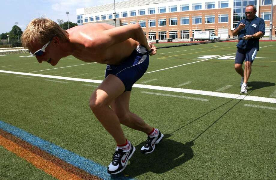 Russian olympic speed skating medalist, Ivan Skobrev, trains with coach, Maurizio Marchetto, on the Brien McMahon High School fields on Monday, June 28, 2010.  Skobrev is in town training and visting family. Photo: B.K. Angeletti / Connecticut Post