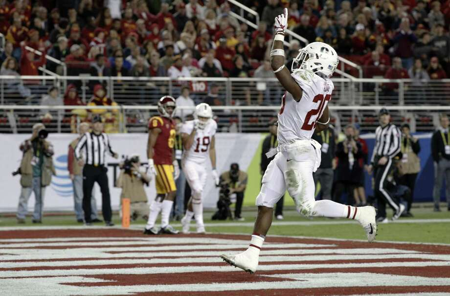 Stanford's Bryce Love, 20 in for a touchdown on a 9 yard run in the 2nd quarter, as the Stanford Cardinal takes on the USC Trojans in the PAC-12 championship game at Levi's Stadium, in Santa Clara Calif. on Fri. December 1, 2017. Photo: Michael Macor / The Chronicle / ONLINE_YES
