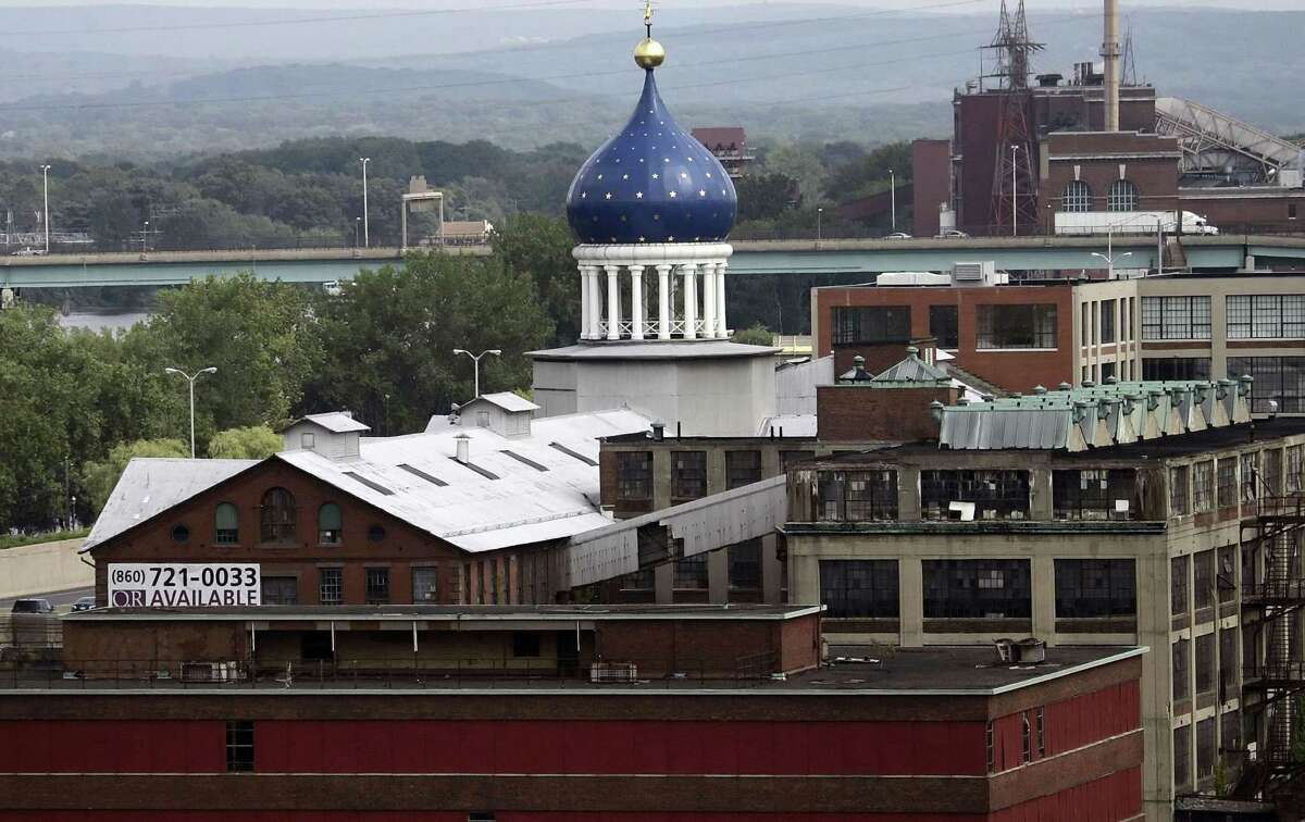 FILE -- In this July 22, 2008 file photo, the blue dome of the former Colt firearms factory sits atop the Coltsville complex in Hartford, Conn. The 179-year-old gun maker filed for chapter 11 bankruptcy on Sunday, June 14, 2015, estimating it owes up to $500 million. Analysts cite several reasons behind Colt's bankruptcy filing, including struggles to recover from the loss of military business and failure to capitalize on consumer interest in guns. (AP Photo/Bob Child, File)