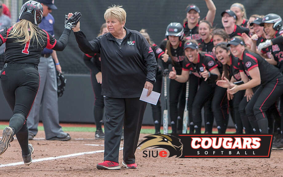 SIUE softball coach Sandy Montgomery congratulates Zoe Schafer at home plate after Schafer hit a home run during a game last season. Photo: SIUE Photo