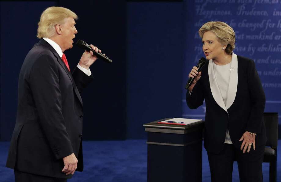 In this file photo, then Republican presidential nominee Donald Trump and Democratic presidential nominee Hillary Clinton speak Oct. 9, 2016 during the second presidential debate at Washington University in St. Louis.  Photo: John Locher /Associated Press / Copyright 2016 The Associated Press. All rights reserved.
