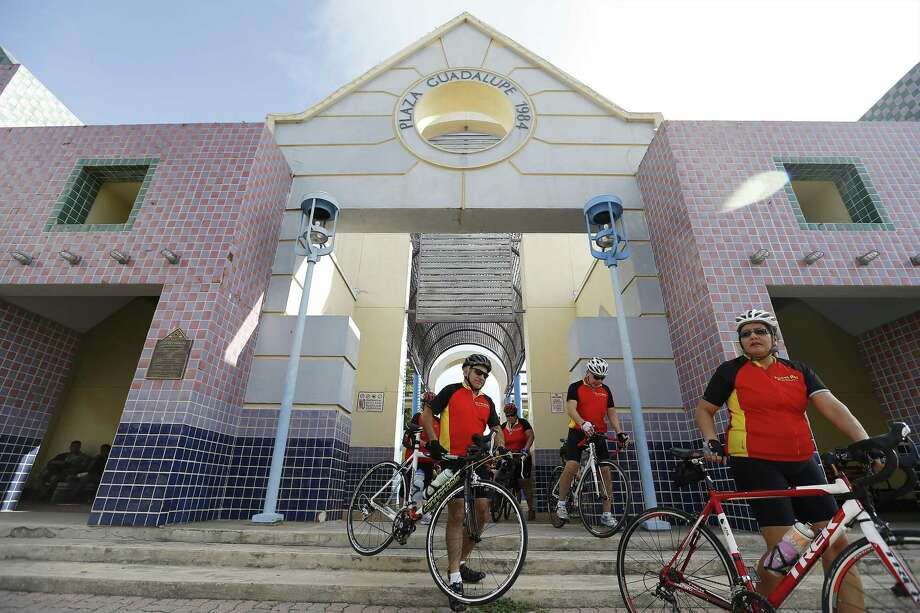 Members of a cycling group leave Guadalupe Plaza in 2015. Millions have been spent renovating parks and plazas around town. Why not Guadalupe Plaza? Photo: Kin Man Hui /Staff File Photo / ©2015 San Antonio Express-News