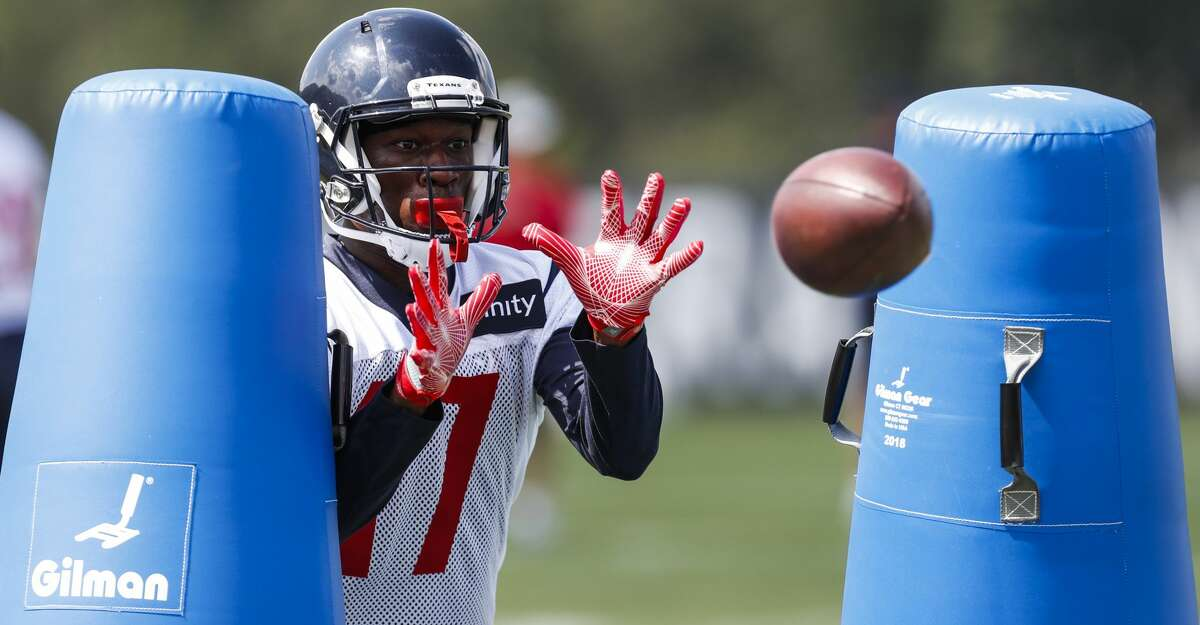 Former Houston Texans wide receiver Vyncint Smith (17) reaches out to make a catch while running a drill during training camp at The Greenbrier Sports Performance Center on Thursday, July 26, 2018, in White Sulphur Springs, W.Va.