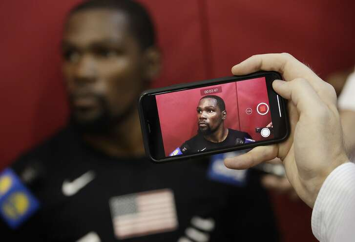A reporter takes video of Kevin Durant during a training camp for USA basketball, Thursday, July 26, 2018, in Las Vegas. (AP Photo/John Locher)