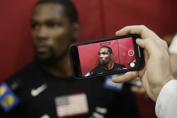 5f81ee9434b3 1of8A reporter takes video of Kevin Durant during a training camp for USA  basketball.Photo  John Locher   Associated Press 2018