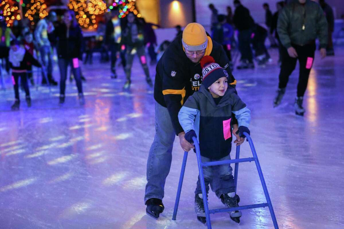 Ice Rink season opens Friday, Nov. 20. The last day of season is Monday, Jan. 18. The Ice Rink Hours are: Monday through Thursday, 3-9 p.m.; Friday, 3-11 p.m.; Saturday, 10 a.m. to 11 p.m.; Sunday, noon to 7 p.m. The Ice Rink is in The Cynthia Woods Mitchell Pavilion event center, 2005 Lake Robbins Drive IN this file photo, Conroe resident Jeremy Leschander helps his son Ethan, 6, learn to skate on Friday, Dec. 29, 2017, at The Ice Rink at The Woodlands Town Center.