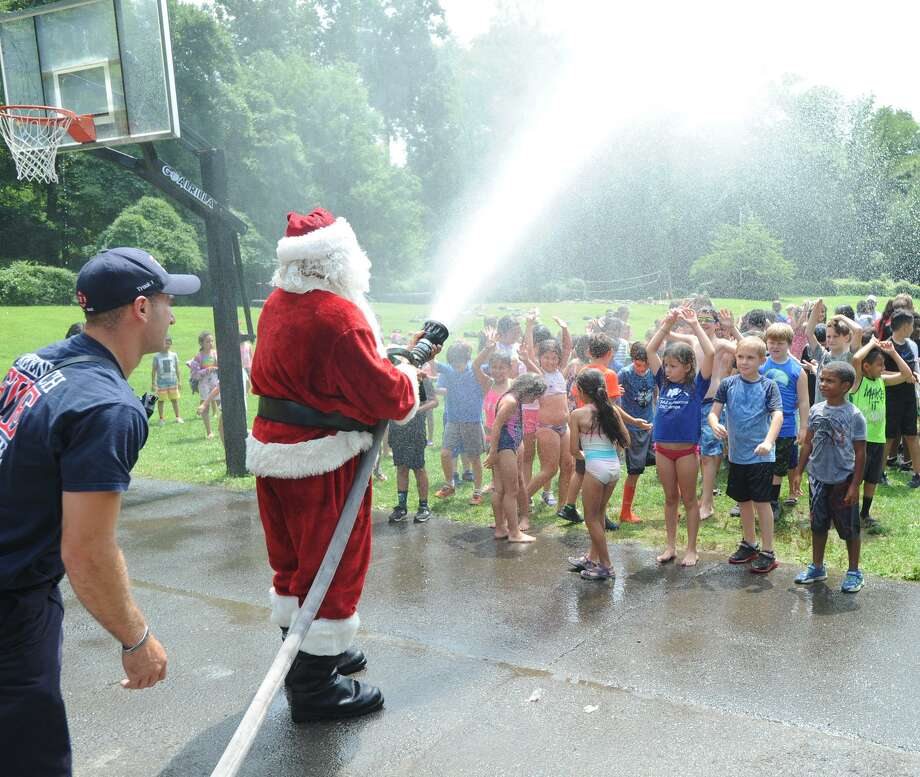 The annual Boys & Girls Club of Greenwich Christmas in July event, courtesy of the Greenwich Fire Department, at Camp Simmons, Greenwich, Conn., Friday, July 27, 2018. Photo: Bob Luckey Jr. / Hearst Connecticut Media / Greenwich Time
