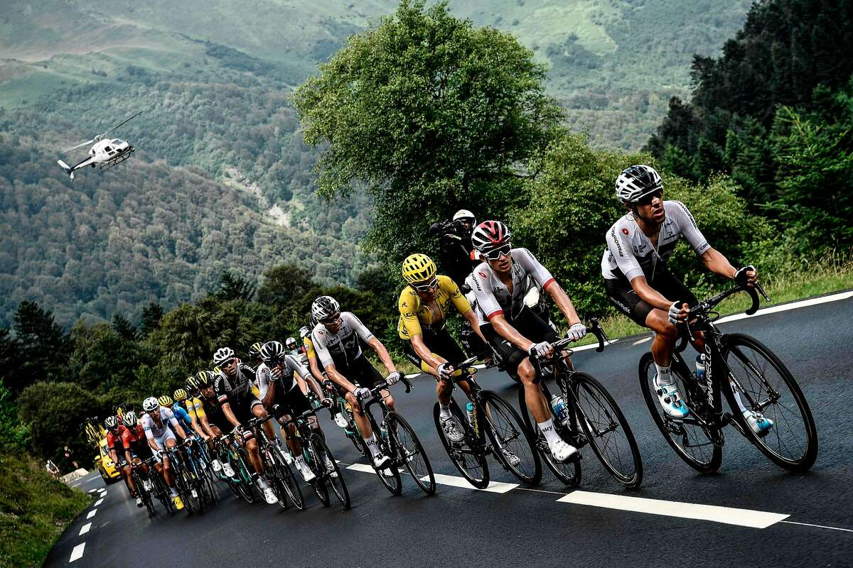 Great Britain's Team Sky cycling team teammates, with Great Britain's Geraint Thomas (3rdR), wearing the overall leader's yellow jersey, ascend with the pack the Col du Tourmalet pass during the 19th stage of the 105th edition of the Tour de France cycling race, on July 27, 2018 between Lourdes and Laruns, southwestern France. / AFP PHOTO / Philippe LOPEZPHILIPPE LOPEZ/AFP/Getty Images