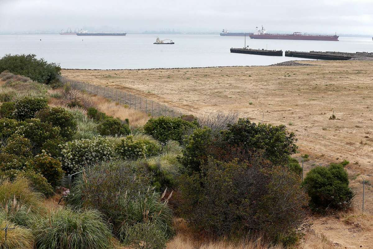 Vacant parcels of land are seen at India Basin in San Francisco, Calif. on Wednesday, July 18, 2018. A park would be created in the area to the right of the fence if a developer's plans to construct more than 1,500 homes are approved on the site off of Innes Avenue and Arelious Walker Drive.