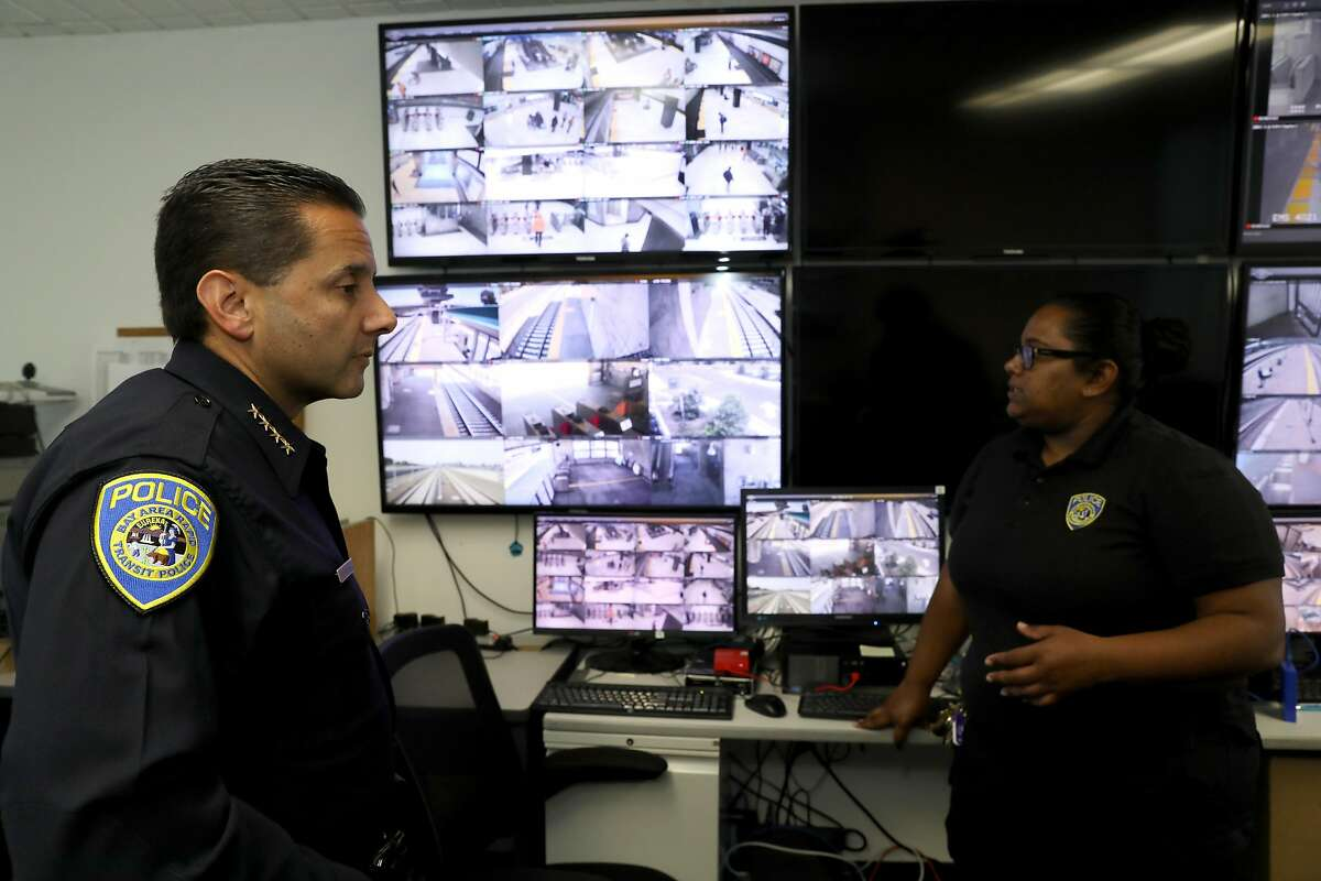 BART Police Chief Carlos Rojas (left) and Aliyyah Shah, San Francisco BART Police community service officer, video recovery unit, discuss the fatal stabbing of Nia Wilson, which occurred at the MacArthur BART station last Sunday, inside the video recovery room at BART Police Headquarters in Oakland, Cali. on Thursday, July 25, 2018.