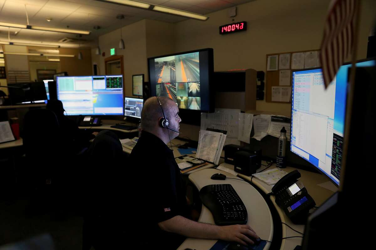A BART police dispatcher, who didn't want to be identified, works in the communications center at BART Police Headquarters in Oakland, Cali. on Thursday, July 25, 2018.