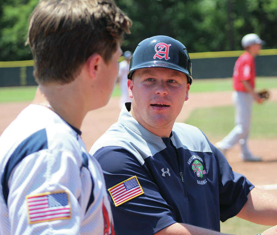 Alton Post 126 manager Nick Paulda (right) talks with Adam Stilts between innings of a game earlier this season in Ballwin, Mo. Alton is the host Post for the Senior Legion Baseball State Tournament starting Saturday at Alton High in Godfrey. Photo:       Greg Shashack / The Telegraph