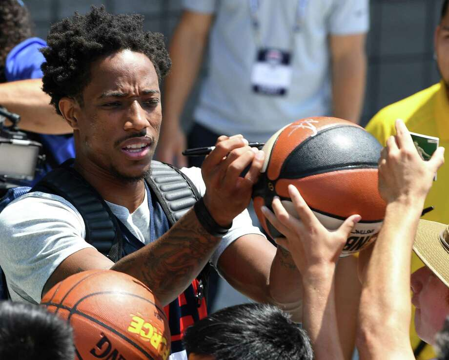 DeMar DeRozan signs autographs for fans after a practice session at the 2018 USA Basketball Men's National Team minicamp at the Mendenhall Center at UNLV on July 26, 2018 in Las Vegas, Nevada. Photo: Ethan Miller /Getty Images / 2018 Getty Images