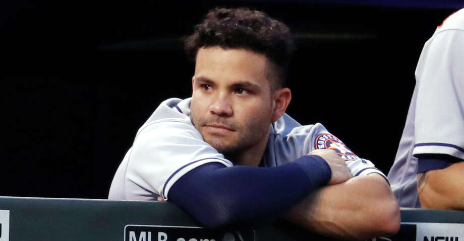 Houston Astros second baseman Jose Altuve, left, leans over the dugout rail next to Marwin Gonzalez during the sixth inning of the team's baseball game against the Colorado Rockies on Wednesday, July 25, 2018, in Denver. (AP Photo/David Zalubowski) Photo: David Zalubowski/Associated Press / Copyright2018 The Associated Press. All rights reserved.