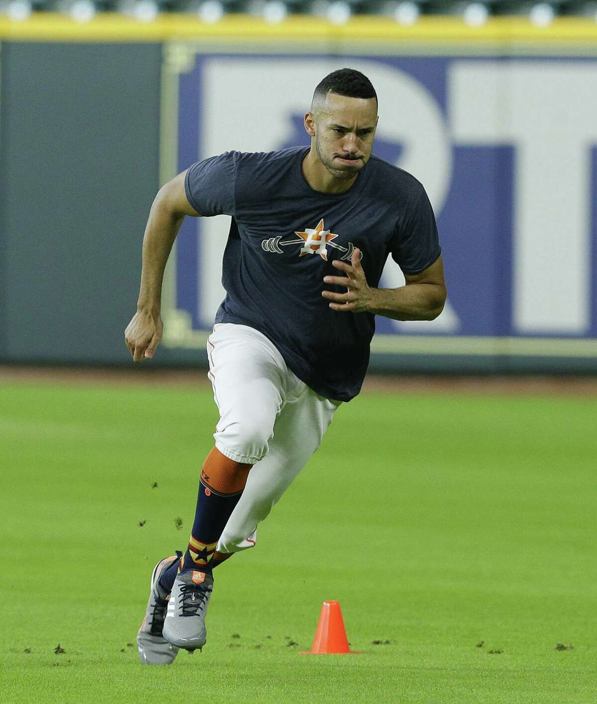 HOUSTON, TX - JULY 27: Carlos Correa #1 of the Houston Astros goes through drills at Minute Maid Park on July 27, 2018 in Houston, Texas. Correa has been on the disabled list with a sore back.