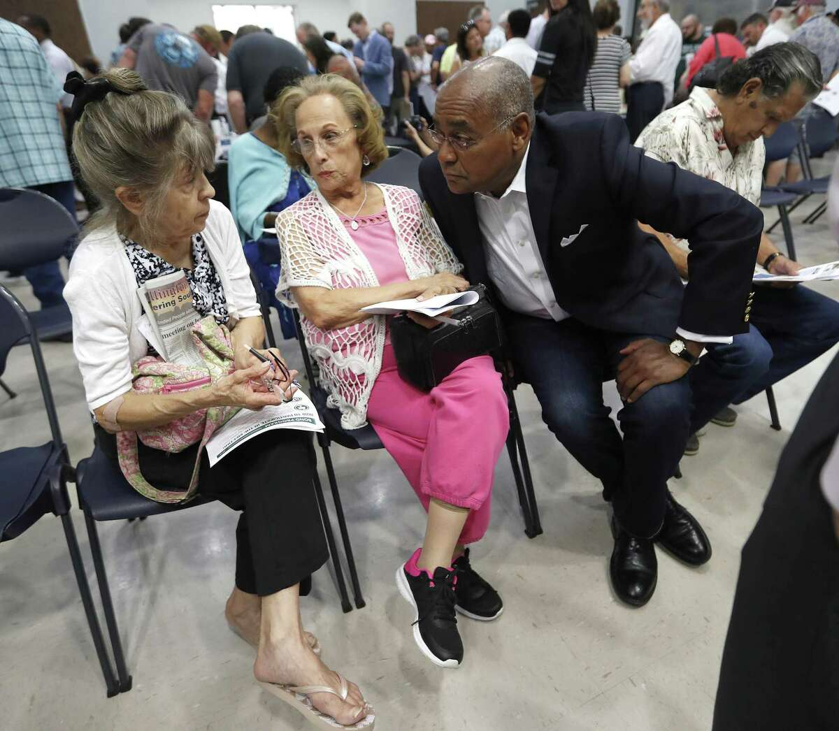 Commissioner Rodney Ellis of Harris County Precinct One speaks to Argelia Pinon, center, and Margret Toman, left, as Harris County held one in a series of public meetings on the $2.5 billion flood bond proposal at the El Franco Lee Community Center, Tuesday, July 17, 2018, in Houston. ( Karen Warren / Houston Chronicle )