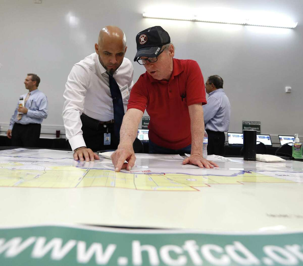 Armando Sanchez, left, helps Don Corolla as they point to a spot on a map as Harris County held one in a series of public meetings on the $2.5 billion flood bond proposal at the El Franco Lee Community Center, Tuesday, July 17, 2018, in Houston. ( Karen Warren / Houston Chronicle )