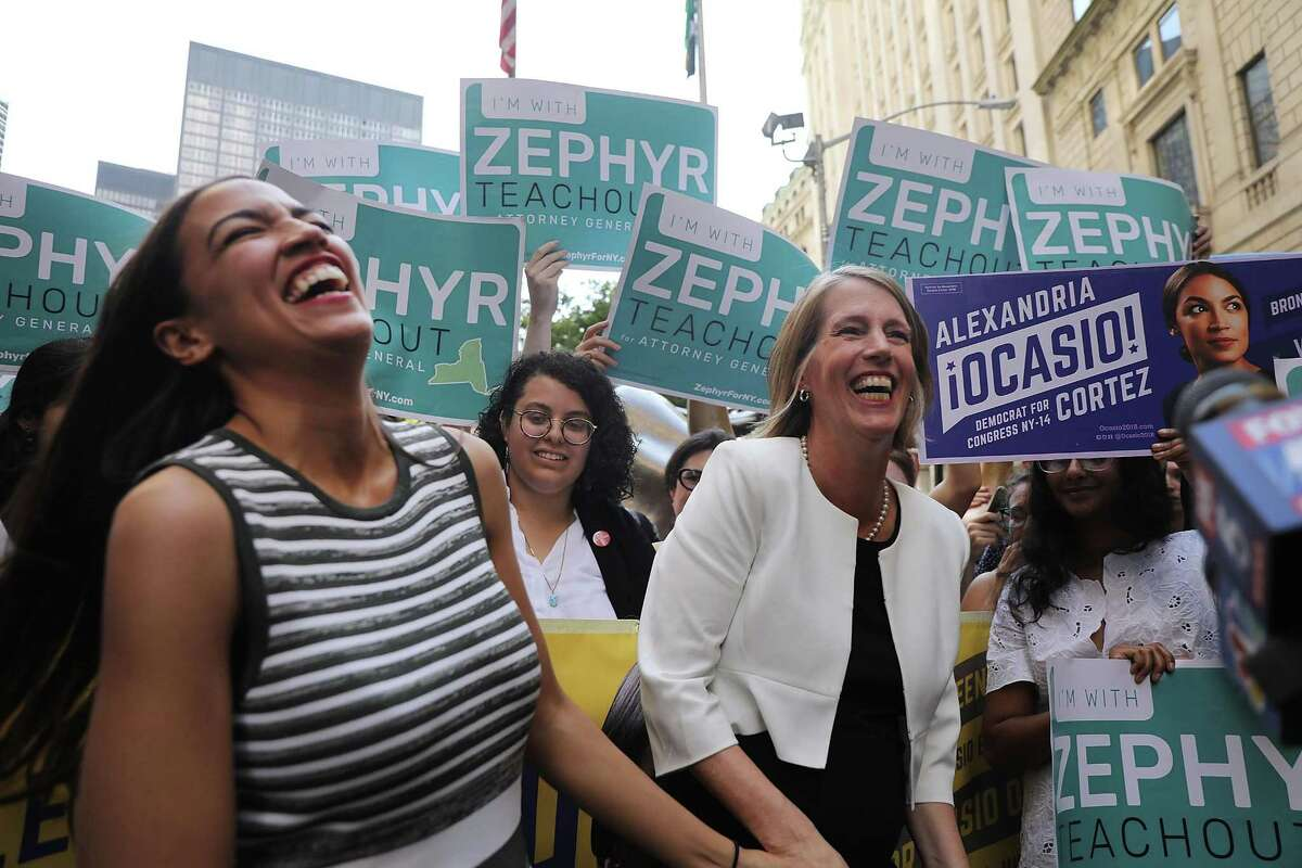NEW YORK, NY - JULY 12: Congressional nominee Alexandria Ocasio-Cortez (L) stands with Zephyr Teachout after endorsing her for New York City Public Advocate on July 12, 2018 in New York City. The two liberal candidates held the news conference in front of the Wall Street bull in a show of standing up to corporate money. Ocasio-Cortez shocked the Democratic political community recently after an upset win against Representative Joe Crowley in the New York Democratic primary.