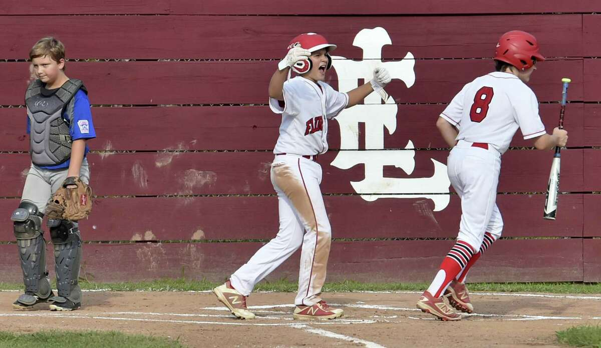 East Lyme, Connecticut - Friday, July 27, 2018: To the dismay of Manchester catcher Easton Masse,left, Charlie Yates of Fairfield American, center, celebrates Fairfield's first run with teammate Pierce Cowles, right, during first inning baseball action against Manchester Little League in the winners bracket of the Little League State playoffs Friday evening at Presidents Field in East Lyme. Fairfield American defeated Manchester 4-1.