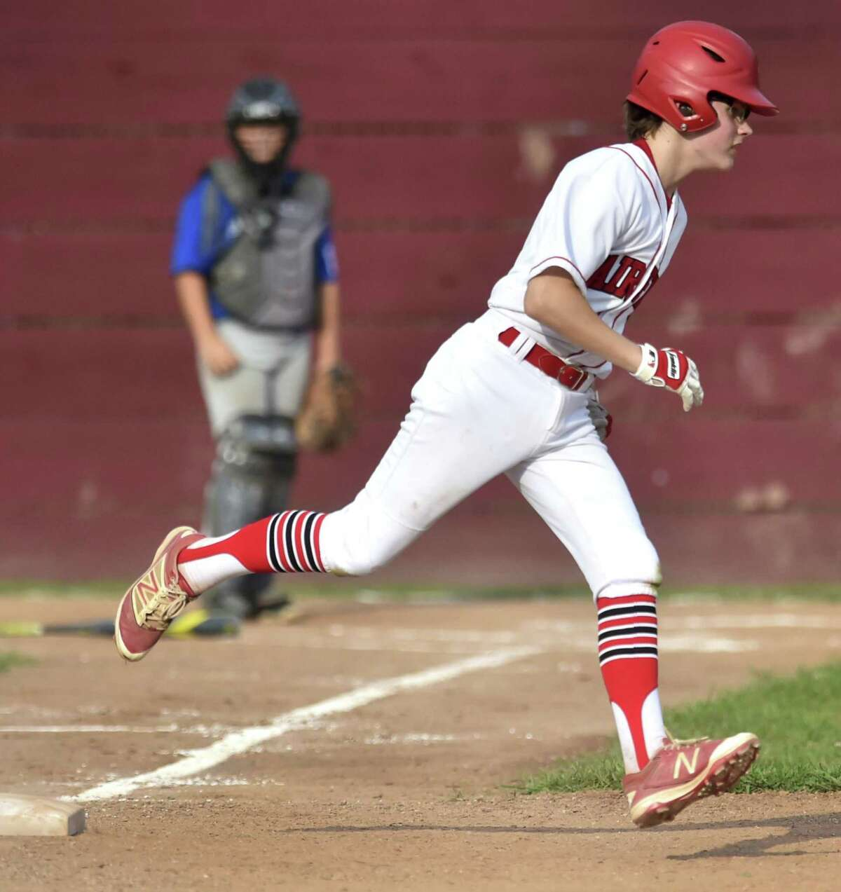 East Lyme, Connecticut - Friday, July 27, 2018: Pierce Cowles of Fairfield American rounds first base after hitting a home run during third inning baseball action against Manchester Little League during the winners bracket of the Little League State playoffs Friday evening at Presidents Field in East Lyme. Fairfield American defeated Manchester 4-1.