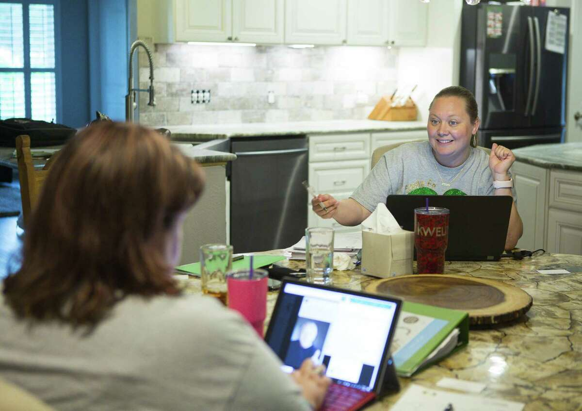 Jamie Zegarelli (right) discusses upcoming plans with Karee Carter while meeting for their new community organization Santa Fe Tribe Moms at Zegarelli's home, Tuesday, July 17, 2018, in Santa Fe, TX. ( Mark Mulligan / Houston Chronicle )