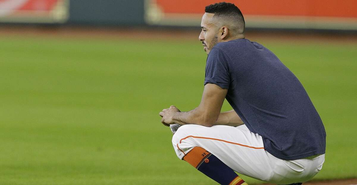 HOUSTON, TX - JULY 27: Carlos Correa #1 of the Houston Astros goes through drills at Minute Maid Park on July 27, 2018 in Houston, Texas. Correa has been on the disabled list with a sore back. (Photo by Bob Levey/Getty Images)