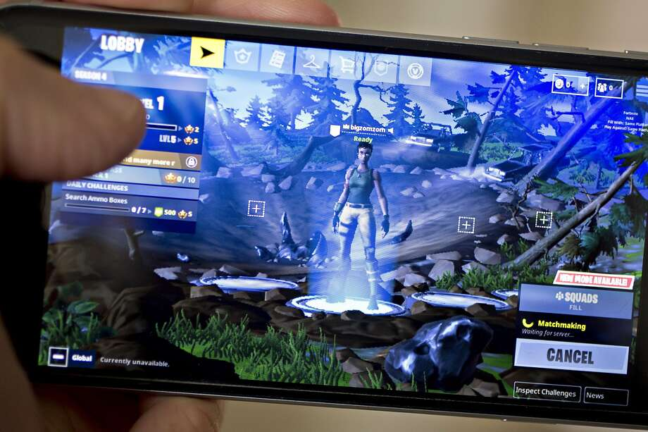 The Epic Games Inc. Fortnite: Battle Royale video game is displayed for a photograph on an Apple Inc. iPhone in Washington, D.C., U.S., on Thursday, May 10, 2018. Fortnite, the hit game that's denting the stock prices of video-game makers after signing up 45 million players, didn't really take off until it became free and a free-for-all. Photographer: Andrew Harrer/Bloomberg Photo: Andrew Harrer, Bloomberg
