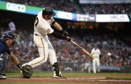 San Francisco Giants third baseman Evan Longoria (10) connects for a single in his first at-bat since returning from the disabled list, during the second inning of a baseball game against the Milwaukee Brewers, Thursday, July 26, 2018, in San Francisco. (AP Photo/D. Ross Cameron)