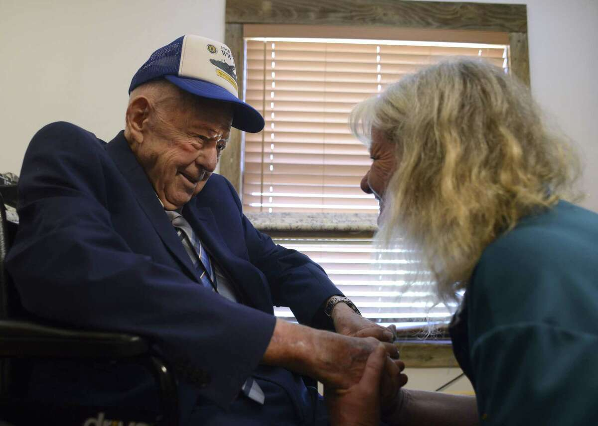 """Retired Air Force Maj. Woodrow """"Woody"""" Wilson Browning is greeted by Cindy Gilsinger, canteen manager at American Legion Post 300, on his 100th birthday on Friday, July 27, 2018. Browning, a veteran of World War II, was the bombardier aboard the B-24 Liberator bomber called """"Nobody's Baby"""" when it was hit by anti-aircraft fire and shot down over Blechhammer, Germany."""