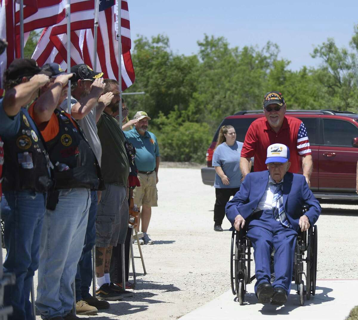 """Retired Air Force Maj. Woodrow """"Woody"""" Wilson Browning is greeted by American Legion Post 300 Riders, Patriot Guard, Combat Vets Association and Sons of American Legion Post 300 at American Legion Post 300 on his 100th birthday on Friday, July 27, 2018. Browning, a veteran of World War II, was the bombardier aboard the B-24 Liberator bomber called """"Nobody's Baby"""" when it was hit by anti-aircraft fire and shot down over Blechhammer, Germany, in 1944."""