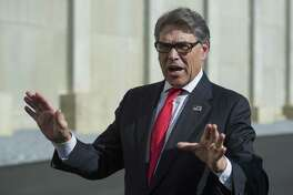 Secretary of Energy Rick Perry speaks with reporters at Dominion Energy's Cove Point LNG liquefaction Project facility in Lusby, Md., Thursday, July 26, 2018. The completion of the facilities export expansion project makes it just the second LNG export facility in the U.S. (AP Photo/Cliff Owen)