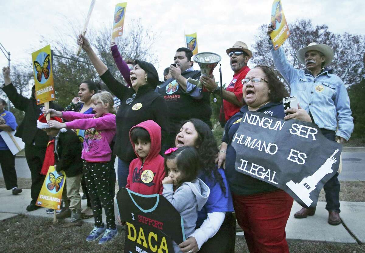 Demonstrators shout out their demand for a clean Dream Act as the president of the Texas State Teachers Association and San Antonio educators rally outside Congressman Will Hurd's office in San Antonio to encourage a vote to extend the Deferred Action for Childhood Arrivals program on December 14, 2017