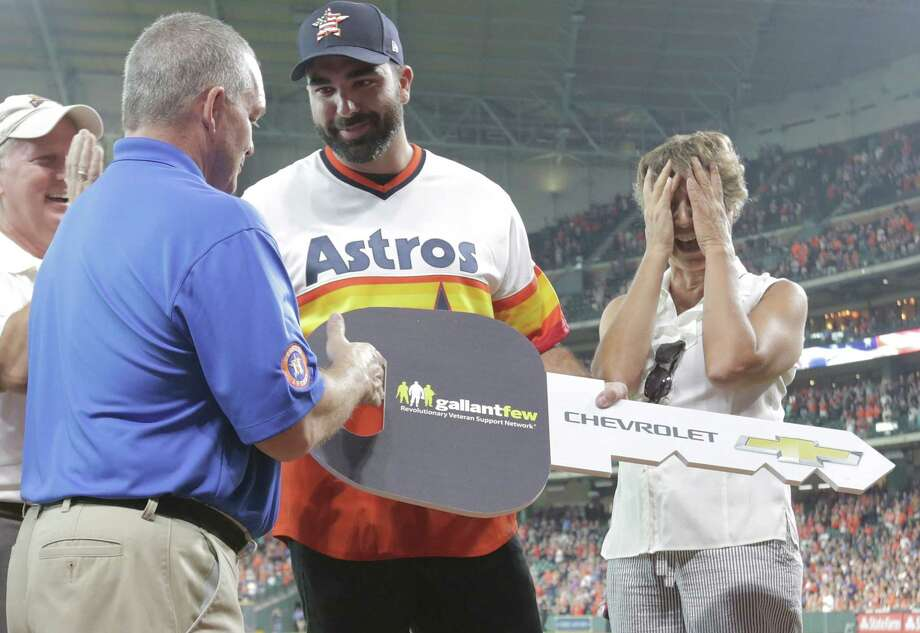 PHOTOS: More from the surprise car giveaway before Friday's Astros game