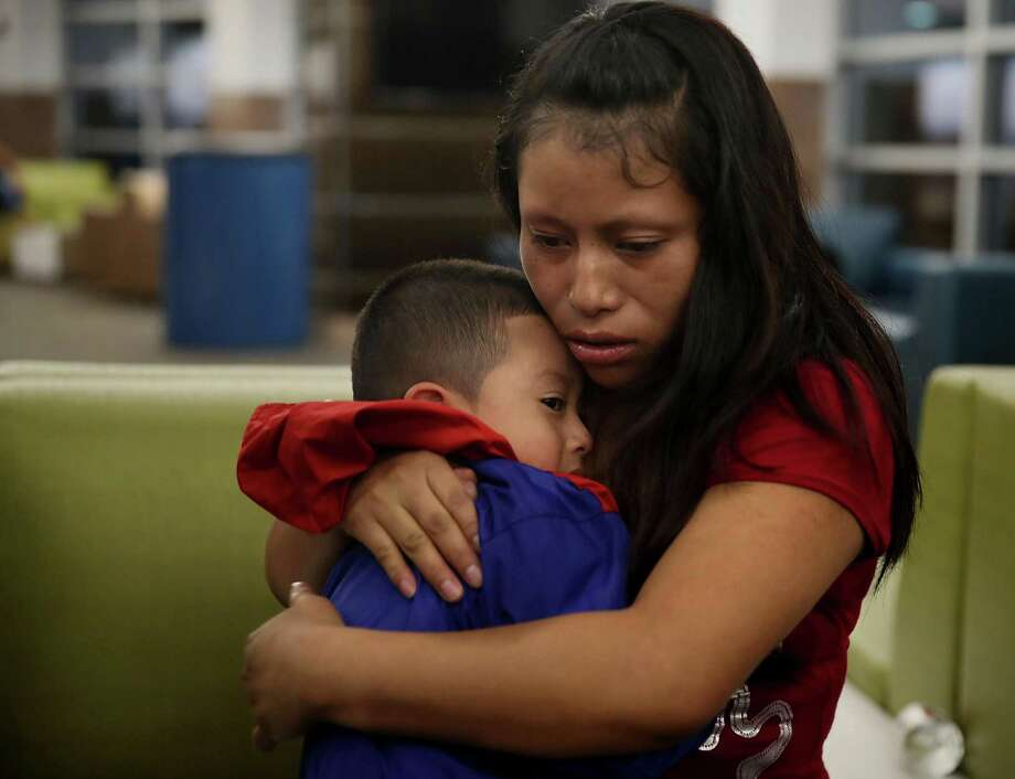 EL PASO, TX - JULY 26:  A woman, identified only as Maria, is reunited with her son Franco, 4,  at the El Paso International Airport on July 26, 2018 in El Paso, Texas. Maria, originally from Guatemala, was reunited with Franco, who was being held in New York, after being separated for one month when they  crossed into the United States. Today was a court-ordered deadline for the U.S. government to reunite as many as 2,551 migrant children ages 5 to 17 that had been separated from their families.  (Photo by Joe Raedle/Getty Images) Photo: Joe Raedle, Staff / Getty Images / 2018 Getty Images